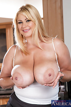 Busty MILF fucks her son's younger friend